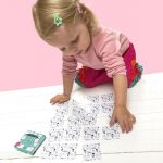 Child playing Picture Pairs Memory Card Game