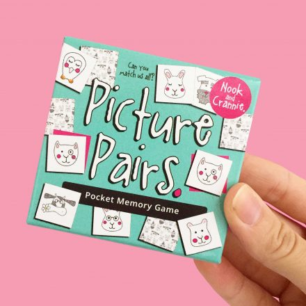Hand holding Picture Pairs Memory Card Game